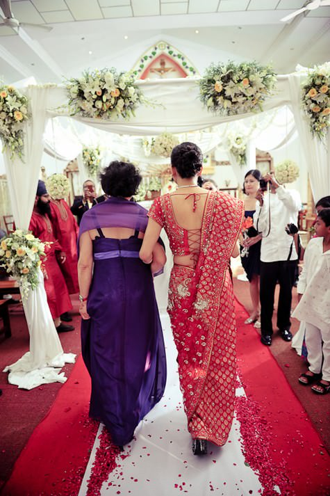 A two day Indian/Chinese/Catholic wedding with four wedding dresses and an elephant