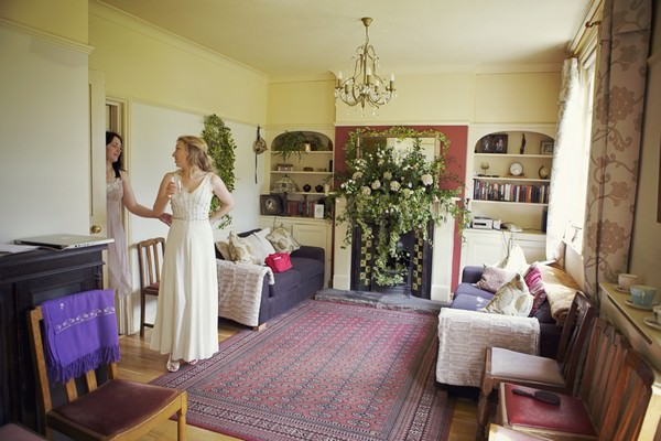 bride in a vintage wedding dress at home