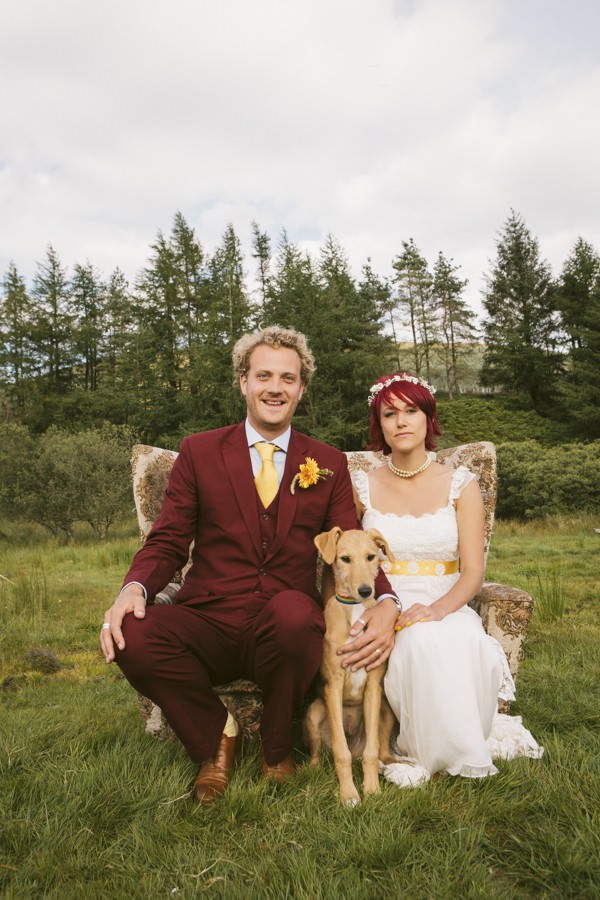 wedding couple in a field with their dog