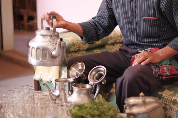 drinking mint tea with a local Bedouin family in the Atlas Mountains