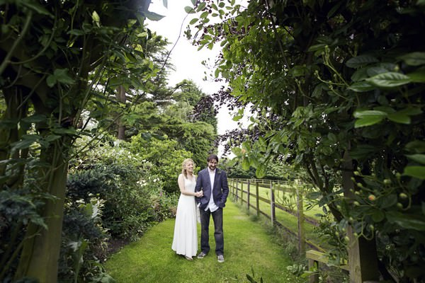 bride and groom in their back garden