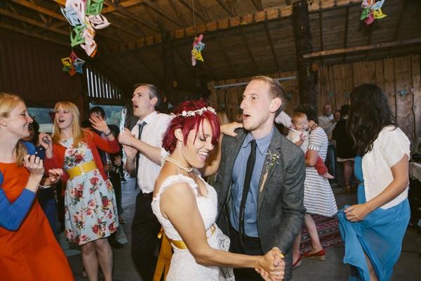 farm wedding dancing in a cow shed