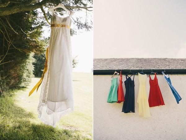 wedding dress and bridesmaids dress hanging up
