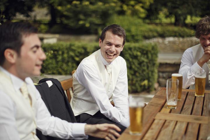 groom having  a drink before the wedding