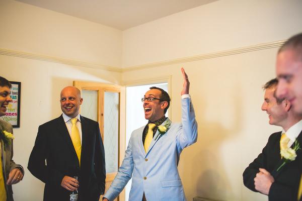 groomsmen in pale blue jacket