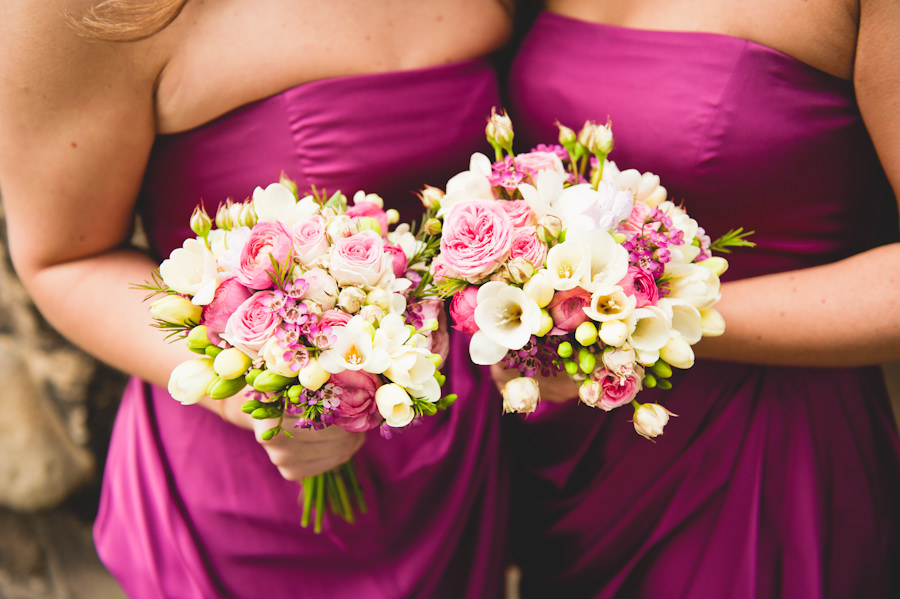 pink bridesmaids with bouquets