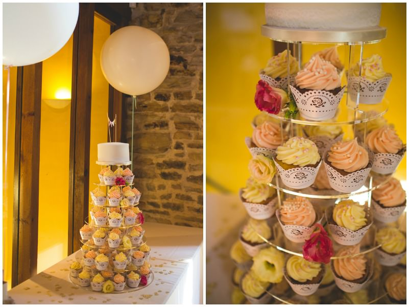 cup cake tower with white balloons