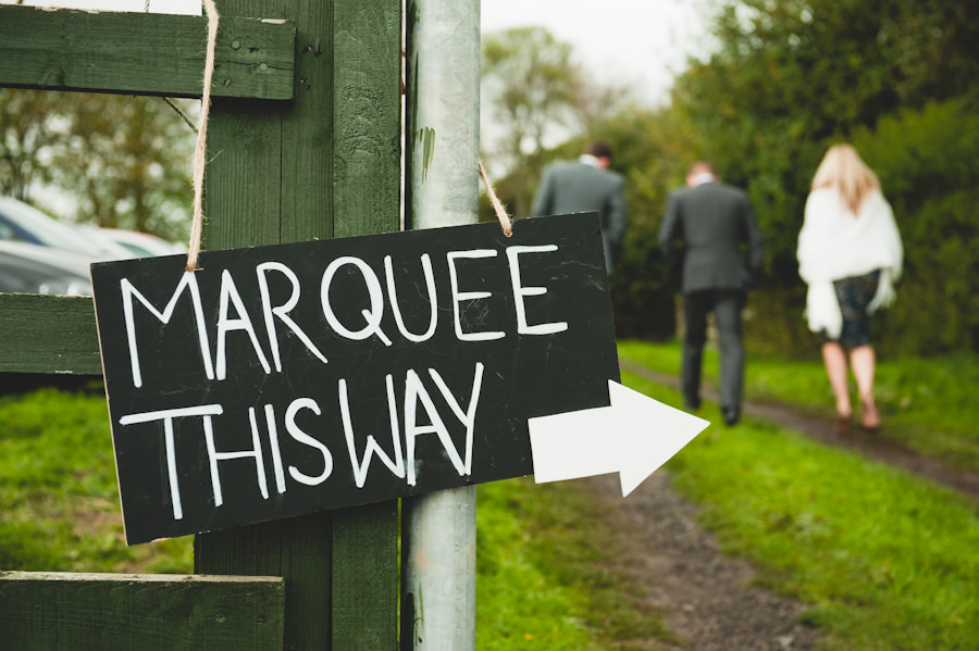 marquee this way wedding sign