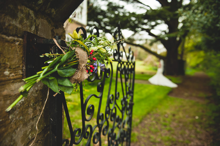 flowers tied to a gate