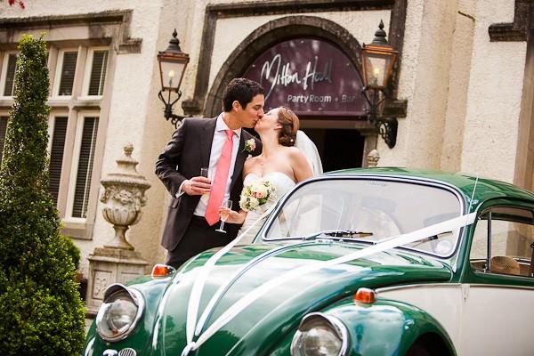 bride and groom by VW beatle wedding car