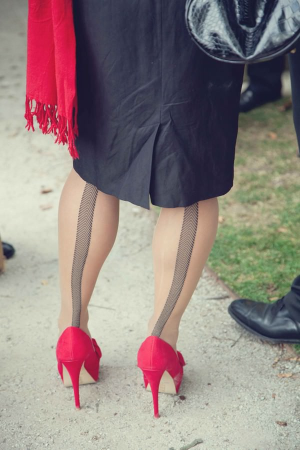 Red Shoes And Seamed Stockings