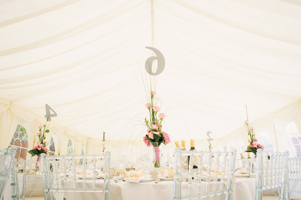 wedding flowers on table in marquee