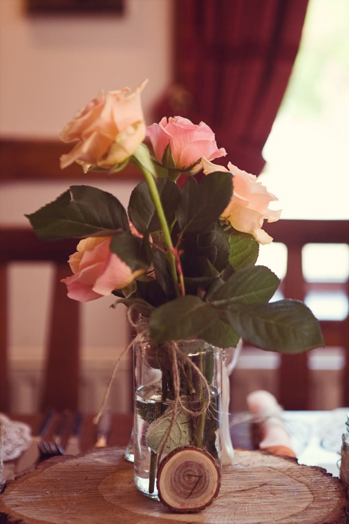 wedding flowers in jam jar
