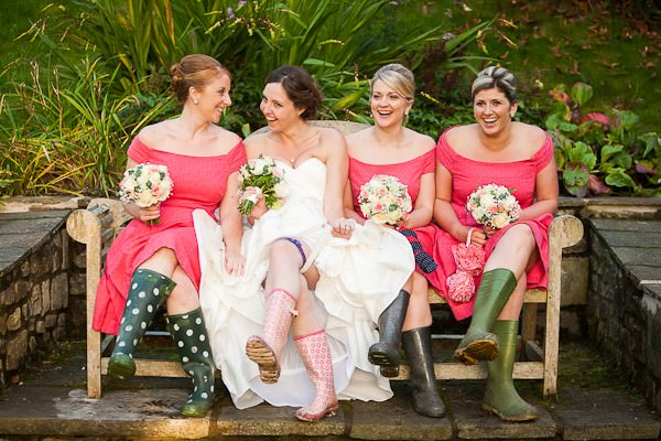 bride and pink bridesmaids in wellies
