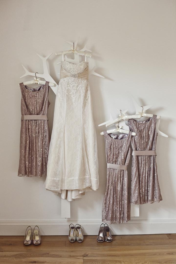 wedding dress and bridesmaids dresses hanging up