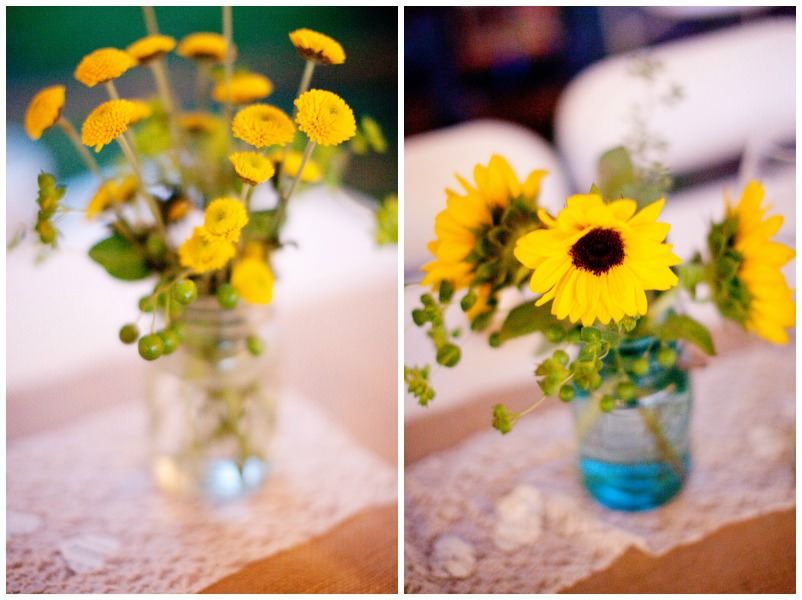 yellow wedding flowers in a mason jar