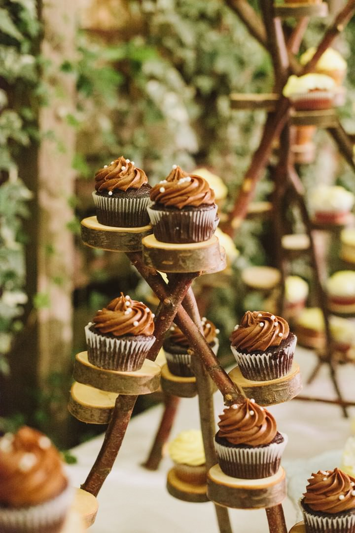 cup cakes on a rustic cake stand