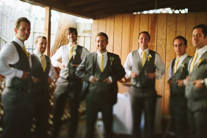 grooms in gray suits and yellow tie
