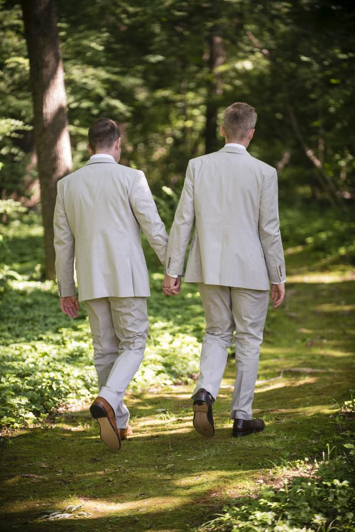grooms getting ready for  their civil partnership