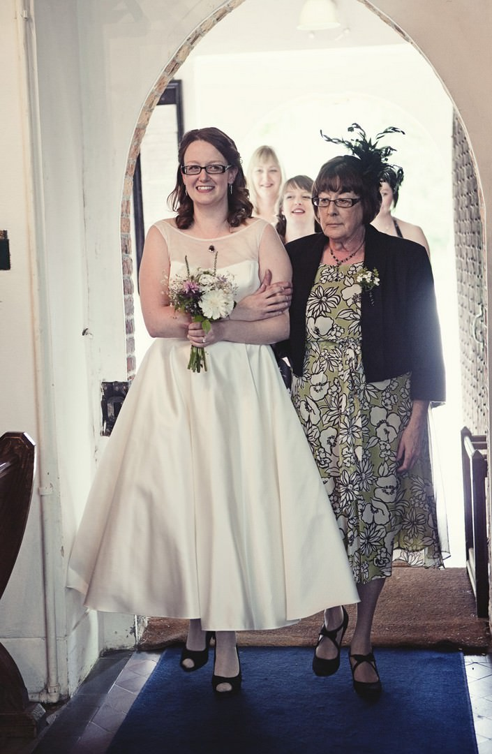 bride and mum entering the church