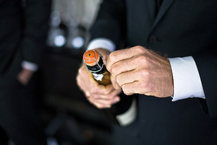 bottle of champagne being opened on a wedding day