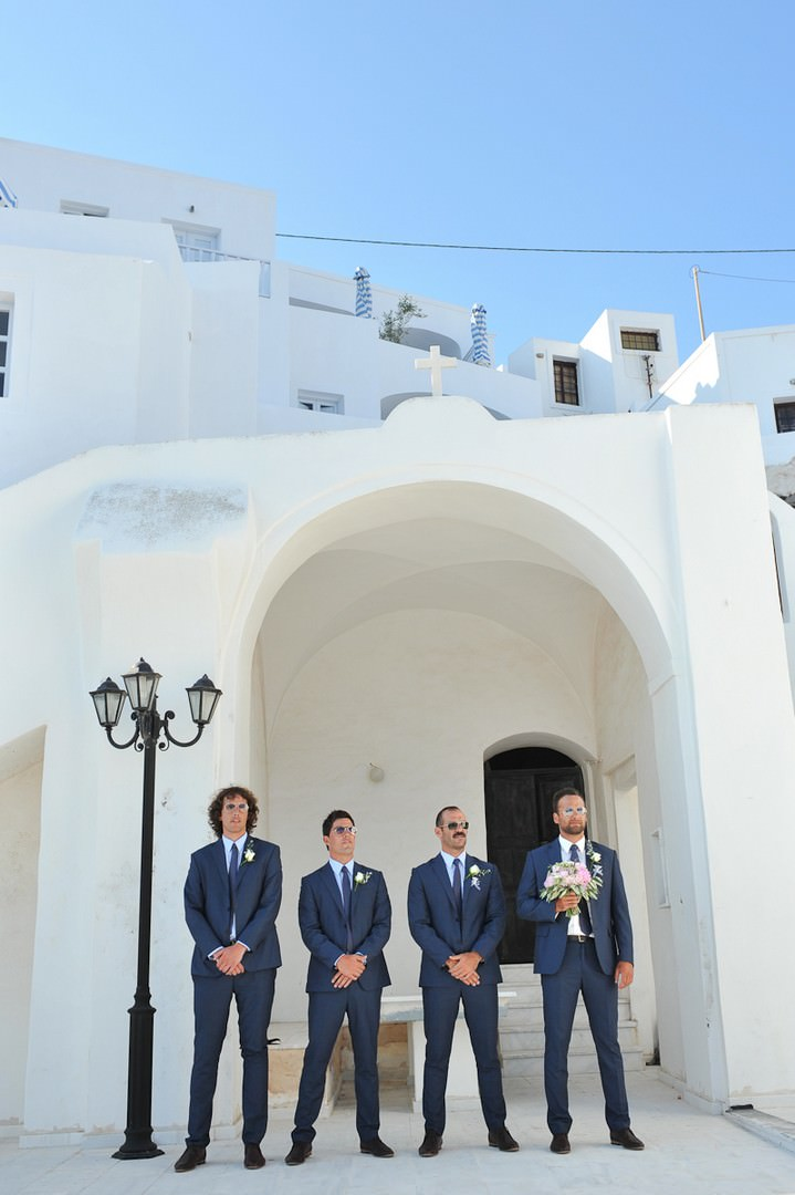groom and groomsmen waiting for the bride