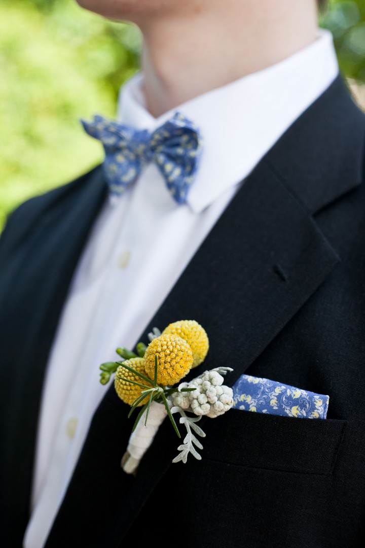 yellow button hole and blue bow tie