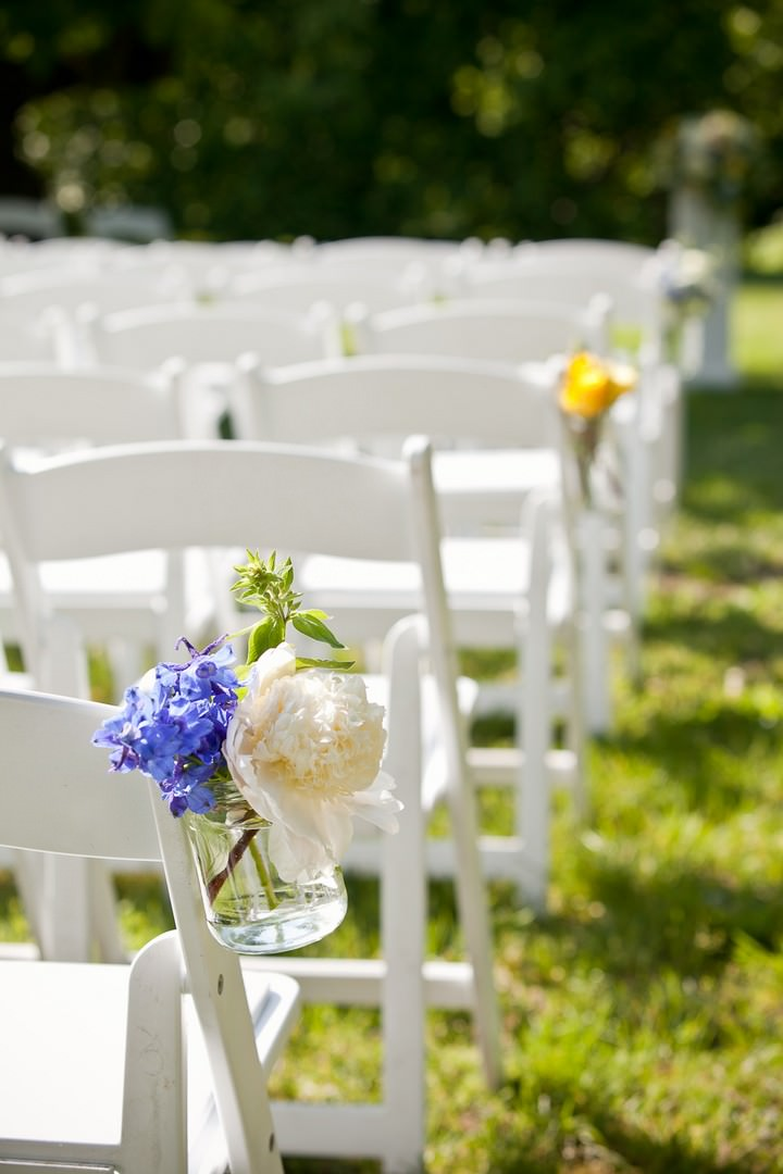 white wedding chairs for an outdoor wedding