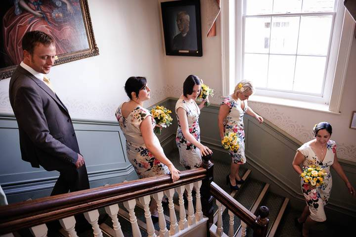 bridesmaids leaving wedding ceremony