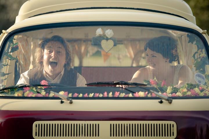 wedding couple in vintage VW camper van
