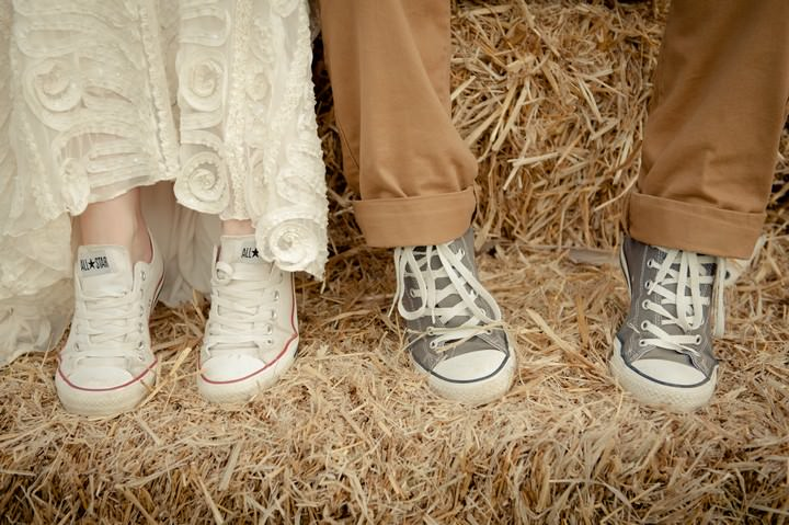 bride and groom on a hay bale