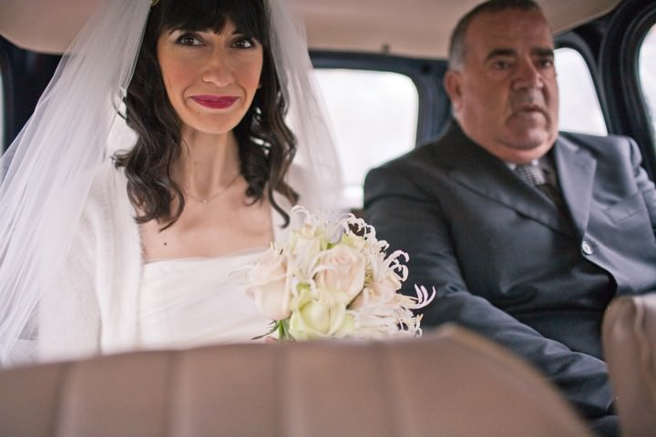 bride with father in her wedding car