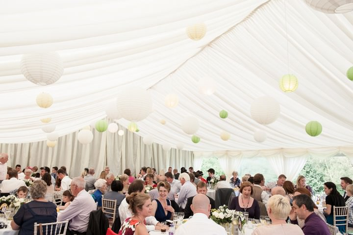 marquee with yellow and lime lanterns