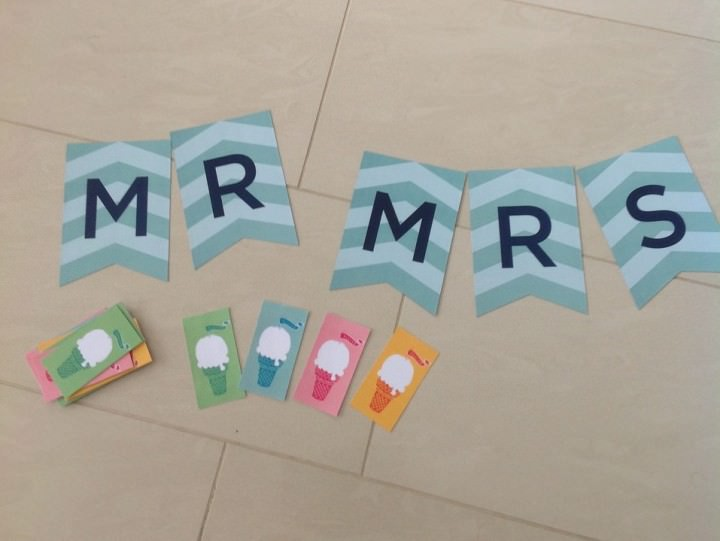 Mr and Mrs sign and ice cream tokens