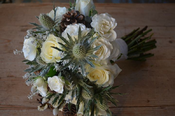 white rose and cone bouquet