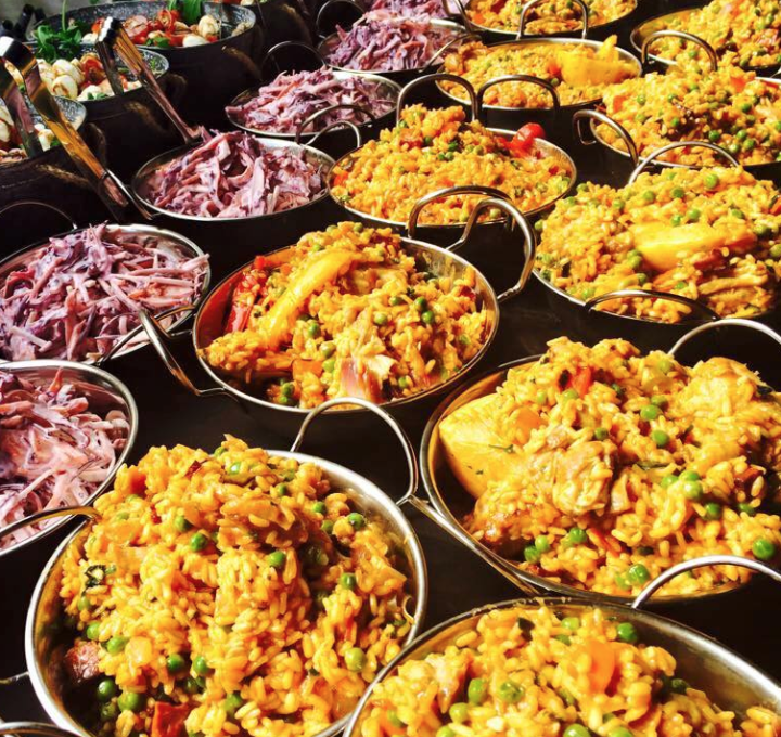 Sharing paella for a wedding