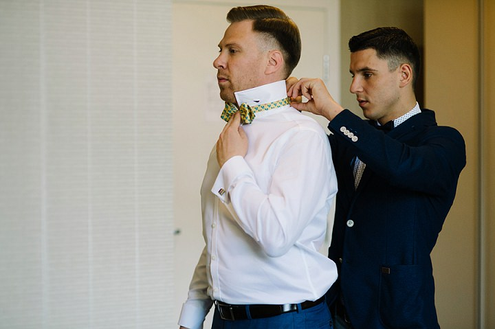 Modern Lithuanian groom wearing bow tie Wedding By Diana Zak Photography