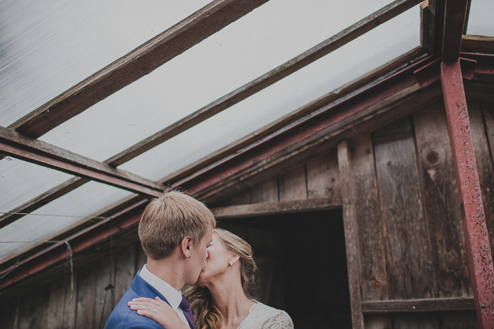 Laid Back Farm Wedding in Estonia kissing By Gerry Sulp Photography