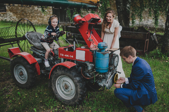 Laid Back Farm Wedding tractor in Estonia By Gerry Sulp Photography