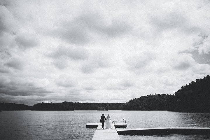 Outdoor Swedish Wedding bride and groom on a pier in Göteborg By Loke Roos Photography