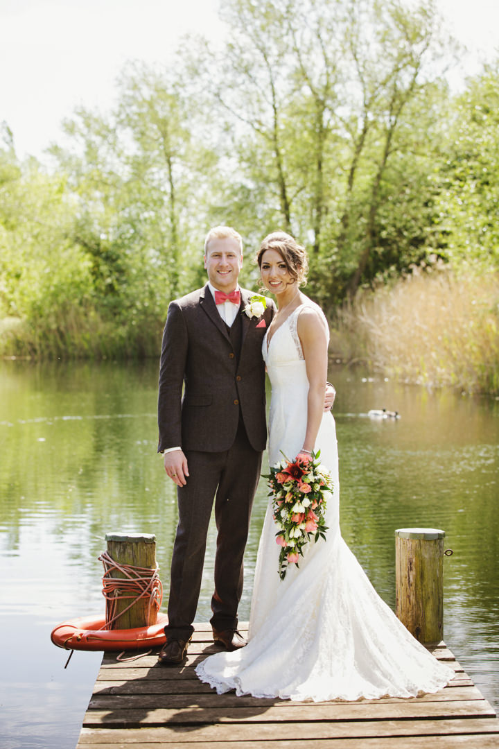 Barn Wedding couple on a pier in Hereford By Gemma William's Photography