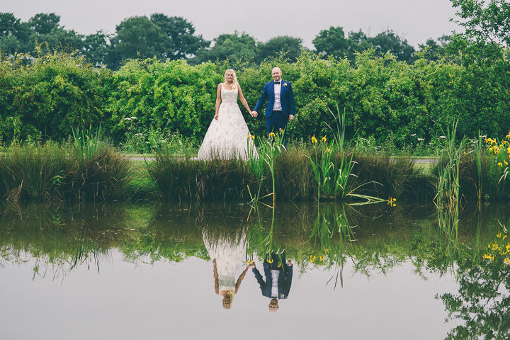 Alrewas Hayes Wedding bride and groom by the pond in Staffordshire by Neil Jackson Photographic