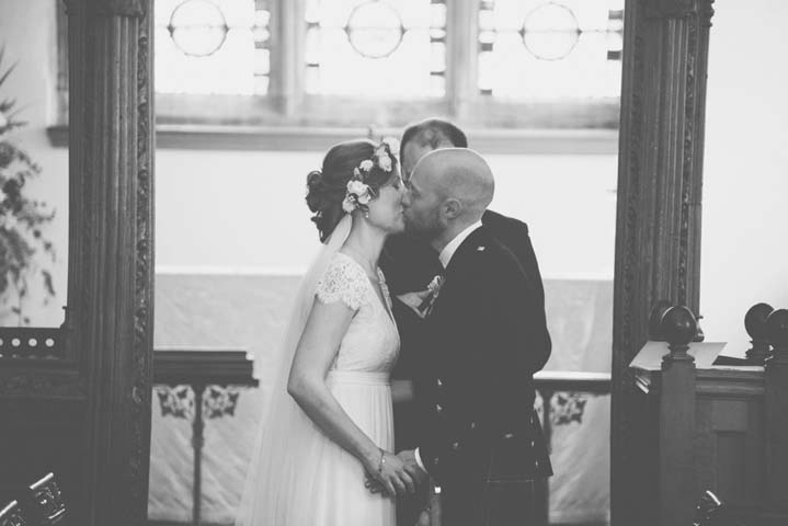 Wedding at The Haymeadow first kiss in Somerset by This and That Photography