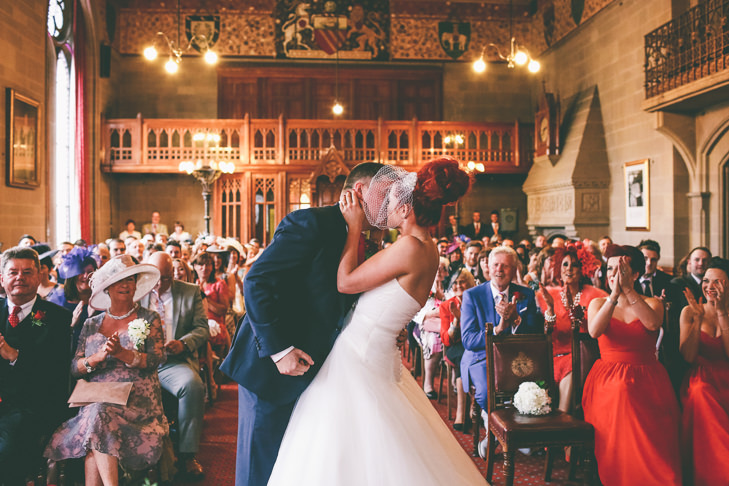 Modern Manchester kissing Town Hall Wedding by Emma Boileau