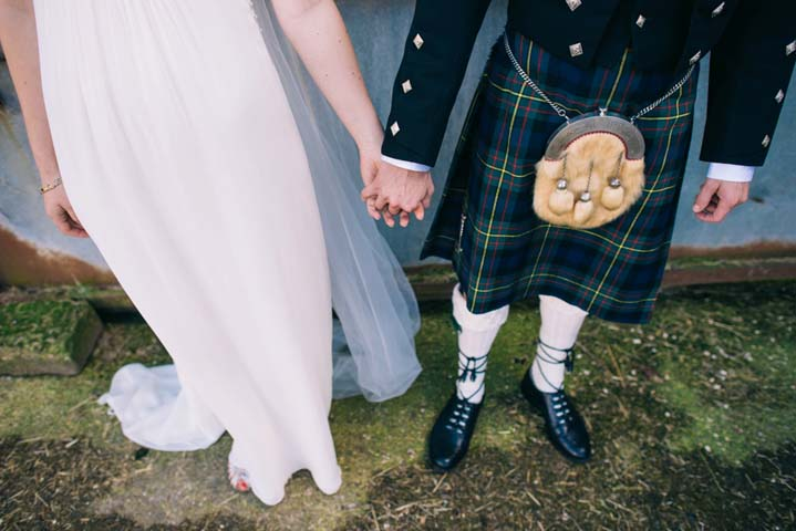 groom wearing kilt at Wedding at The Haymeadow in Somerset by This and That Photography