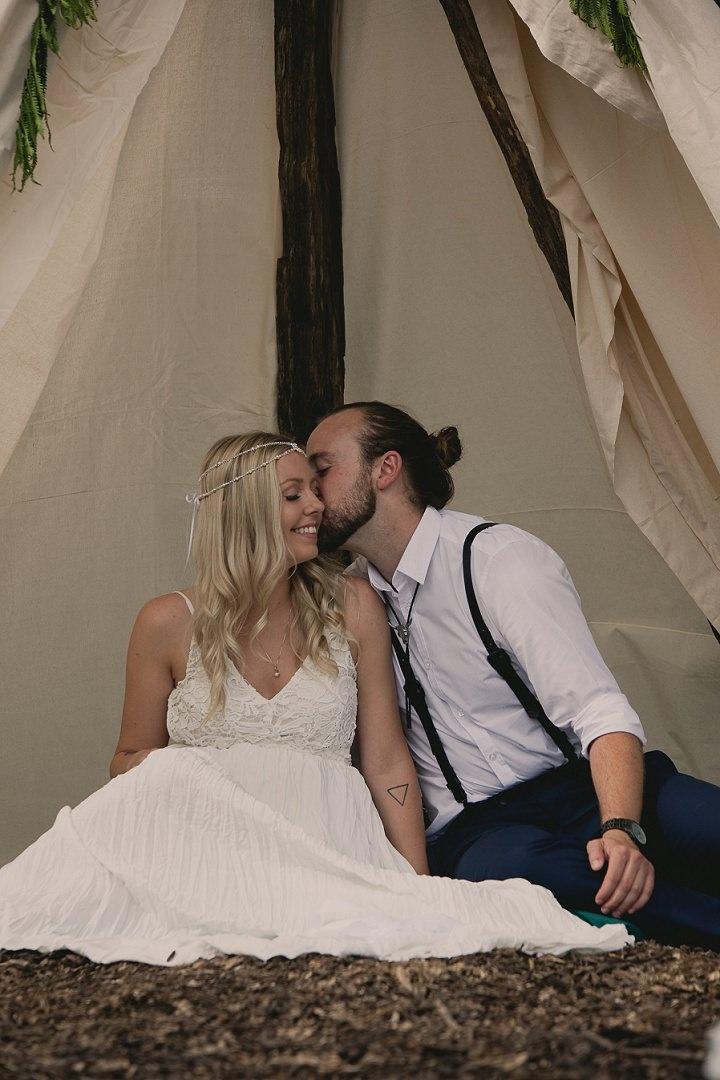 Bohemain Ontario couple kissing Wedding By Sophia Lemon Photography