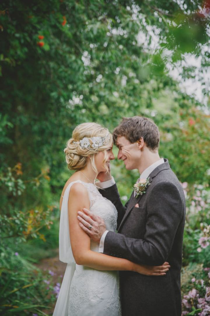 Emily and Jonny's Rustic Peach and Grey couple kissing Barn Wedding By Soul Images