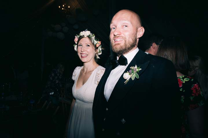 Wedding with bride wearing flower crown at The Haymeadow in Somerset by This and That Photography