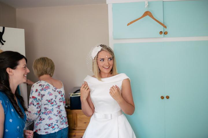 Yorkshire Barmbyfield bride wearing birdcage veil Barns Wedding By Stott and Atkinson