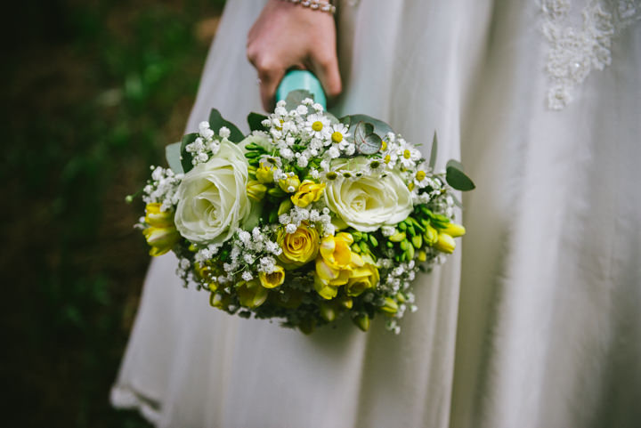 Wedding at Pinewood Studios with yellow bouquet